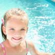 Pretty little girl in swimming pool — Stock Photo