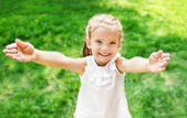 Cute smiling little girl giving her hands — Stock Photo