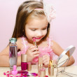 Stock Photo: Child cosmetics Cute little girl with lipstick and mirror