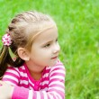 Stock Photo: Portrait of thoughtful cute little girl looking away