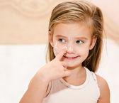Cute little girl applying cream — Stock Photo