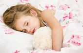 Adorable little girl sleeping in the bed — Stock Photo