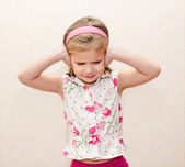 Little girl covering her ears — Stock Photo