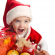 Happy little girl with gift christmas boxes balls and hat — Stok fotoğraf