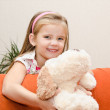 Cute smiling little girl having fun with her toy — Stock Photo #33323979