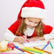 Little girl writes letter to Santa  — Stock Photo
