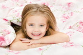 Adorable smiling little girl awaked up — Stock Photo