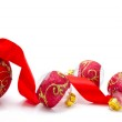Red christmas balls with ribbon isolated on a white — Stock Photo #34795521