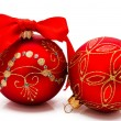 Two red christmas balls with ribbon isolated on a white — Stock Photo