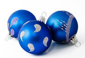 Three blue christmas balls isolated on a white — Stock Photo