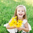 Cute little girl on the meadow with flower in summer day — Stock Photo
