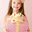 Portrait of little girl with gift box — Stock Photo