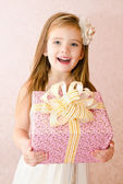 Portrait of cute little girl with gift box — Stock Photo