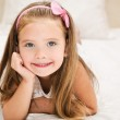 Cute little girl resting on the bed — Stock Photo