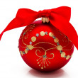 Red christmas ball with ribbon isolated on a white — Stock Photo