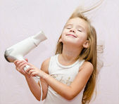 Cute smiling Little girl dries hair — Stock Photo