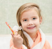 Cute little girl with brush in bath — Stock Photo
