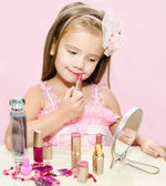 Child cosmetics Cute little girl with lipstick — Stock Photo