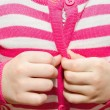 Little girl buttoning her jacket — Stock Photo #37773499