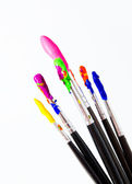 Six paint brushes with gouache isolated on white — Stock fotografie