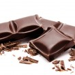 Dark chocolate bars stack with crumbs isolated on a white — Stock Photo
