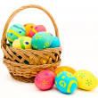 Colorful easter eggs in the basket isolated on a white — Stock Photo #41552281