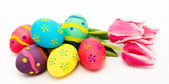 Colorful easter eggs and flowers isolated on a white  — Stock Photo