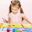 Cute little girl drawing with paint and paintbrush — Stock Photo #42398439