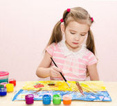 Cute little girl drawing with paint and paintbrush — Stock Photo