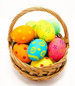 Colorful handmade easter eggs in the basket isolated — Stock Photo