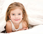 Adorable smiling little girl waked up — Stock Photo