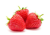 Three perfect red ripe strawberry isolated — Stock Photo