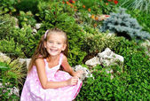 Portrait of adorable little girl in the park  — Stock Photo