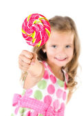Happy little girl with lollipop foreground isolated — Stock Photo
