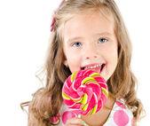 Happy little girl with lollipop isolated — Stock Photo