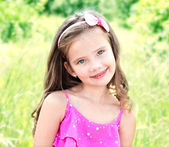 Portrait of adorable smiling little girl — Stock Photo