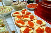 Red caviar - the traditional holiday table decoration. — Stock Photo
