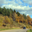 Road along the hills - autumn landscape. — Stock Photo