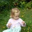 Royalty-Free Stock Photo: Little Baby girl and dandelion