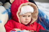 The little girl on a walk in the stroller — Foto Stock