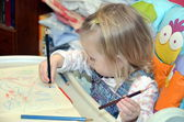 The drawing girl — Stock Photo