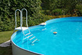 White ladder and summer swimming pool — Foto de Stock