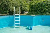 Cleaning the home pool — Stock Photo