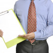Businessman Holding Clipboard — Stock Photo #23971921