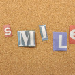 Stock Photo: Smile Word Made From Newspaper Letter
