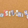 Stok fotoğraf: Positioning Word Made From Newspaper Letter