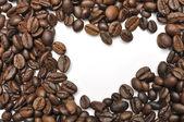 Srdce tvar kávová zrna — Stock fotografie