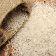 White Rice In Burlap Back — Stock Photo
