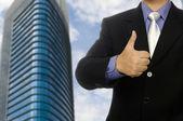 Obchodní muž ukazují palec — Stock fotografie