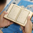 Young Man Reading The Holy Koran — Stock Photo #27461483